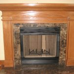 Fireplace /Wood Burning with Marble surround Stained Mantel to match all wood in home