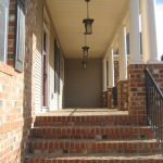 Brick Steps and Front Piers with Vinyl Columns to a Grand Entrance!